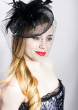 Portrait of a fashionable Elegant beautiful girl with red lips and a veil Stock Photography