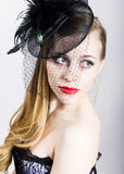 Portrait of a fashionable Elegant beautiful girl with red lips and a veil Stock Photo