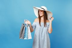 Portrait fashionable elegant fashion beautiful caucasian woman in summer dress, white large wide brim sun hat holding. Packages bags with purchases after royalty free stock photos