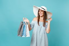 Portrait fashionable elegant fashion beautiful caucasian woman in summer dress, white large wide brim sun hat holding. Packages bags with purchases after stock photography