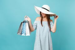 Portrait fashionable elegant fashion beautiful caucasian woman in summer dress, white large wide brim sun hat holding. Packages bags with purchases after stock image