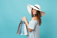 Portrait fashionable elegant fashion beautiful caucasian woman in summer dress, white large wide brim sun hat holding. Packages bags with purchases after royalty free stock images