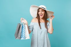 Portrait fashionable elegant fashion beautiful caucasian woman in summer dress, white large wide brim sun hat holding. Packages bags with purchases after stock images
