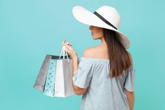 Portrait fashionable elegant fashion beautiful caucasian woman in summer dress, white large wide brim sun hat holding. Packages bags with purchases after royalty free stock photo