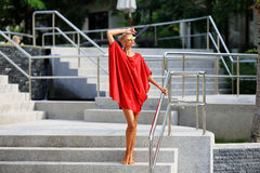 Portrait of fashionable girl in red dress royalty free stock photo