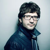 Portrait of fashionable handsome man in blue jacket Stock Images