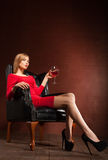 Portrait of fashionable model sitting in armchair Stock Images