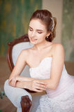 Portrait of a fashionable model sitting in a chair in Art Nouveau style.  Royalty Free Stock Photos