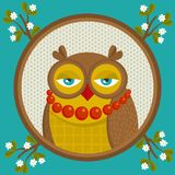 Portrait of fashionable owl in the frame with branch in flowers. Royalty Free Stock Photography