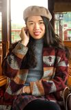 Portrait of fashionable asian girl in a wooden tourist boat. Portrait of fashionable pretty asian girl in a wooden tourist boat Stock Image