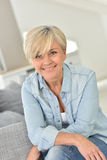 Portrait of fashionable senior woman at home Stock Photo