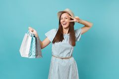Portrait fashionable smiling beautiful caucasian woman in summer dress, straw hat holding packages bags with purchases royalty free stock photos