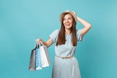 Portrait fashionable smiling beautiful caucasian woman in summer dress, straw hat holding packages bags with purchases stock photos