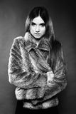 Portrait of young woman in fur dark background Royalty Free Stock Photography