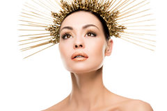 Portrait of fashionable woman posing in golden headpiece Royalty Free Stock Photo
