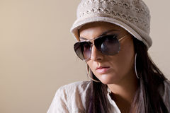 Portrait of fashionable women wearing sunglasses. Isolated on white Stock Photos