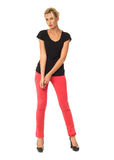 Portrait of fashionable young model dressed in red pants Stock Photo