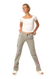 Portrait of fashionable young model dressed in sport pants Stock Photos