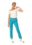 Portrait of fashionable young model dressed in turquoise pants. Portrait of fashionable young woman dressed in turquoise pants Stock Images
