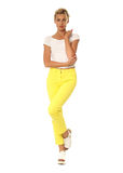 Portrait of fashionable young model dressed in yellow pants Royalty Free Stock Photography