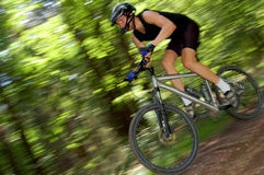 Portrait of fast moving cyclist Stock Images