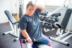 Fat girl in a gym royalty free stock image