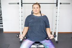 Fat girl in a gym royalty free stock photos