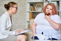 Obese Woman Consulting about   Eating Disorder Stock Image