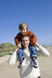 Portrait of father carrying son on shoulder Stock Photography