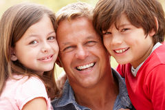 Portrait father and children outdoors Royalty Free Stock Image