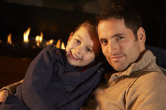 Portrait father and daughter by firelight Stock Photo
