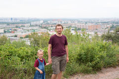 Portrait of father and daughter on a hill Stock Images
