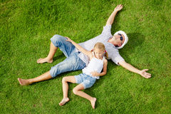 Portrait a father and daughter lying on the grass at the day tim Royalty Free Stock Photography