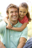 Portrait Of Father And Daughter In Park Royalty Free Stock Photography