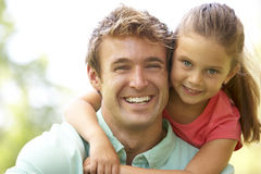 Portrait Of Father And Daughter In Park Stock Photography