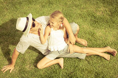 Portrait a father and daughter sitting on the grass at the day t Royalty Free Stock Image