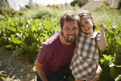 Portrait Of Father And Daughter Standing On Community Allotment stock photography