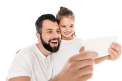 portrait of father and daughter taking selfie on smartphone together royalty free stock photo