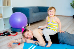 Father doing exercises with daughter Stock Images