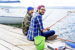 Father and son fishing. A portrait of father fishing with his son Royalty Free Stock Photography