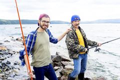 Father and son fishing. A portrait of father fishing with his son Royalty Free Stock Images