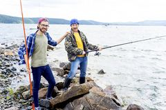 Father and son fishing. A portrait of father fishing with his son Stock Images