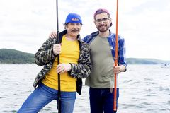 Father and son fishing. A portrait of father fishing with his son Stock Photo
