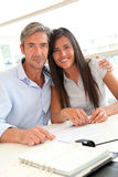 Portrait of father and girl in real-estate agency Royalty Free Stock Photo