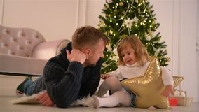 Portrait of Father With Her Cute Daughter. Christmas Tree And Gifts On Background. Fathers Day. Happy New Year. HD, Together, Love stock video