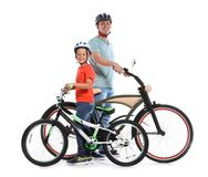 Portrait of father and his son with bicycles. On white background stock images