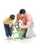 Portrait of father and his son child repair a broken bicycle together at home Stock Photography
