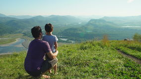Portrait of Father with his son looking to the mountains stock footage
