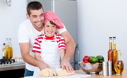 Portrait of a father and his son preparing a meal Stock Images