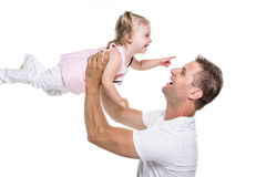Portrait of father holding his adorable child on white background. A portrait of father holding his adorable child on white background Stock Images